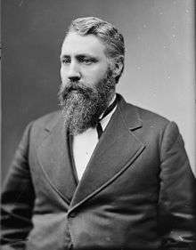 Vintage Black and White photo of a bearded man with a suit