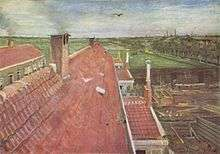 A view from a window of pale red rooftops. A bird flies in the blue sky; in the near distance there are fields and to the right, the town and other buildings can be seen. On the distant horizon are chimneys.